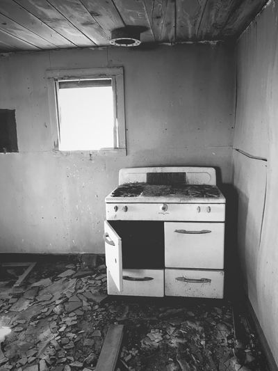 """""""Once Upon A Time In Cedarvale No. 7"""" Everything but the kitchen stove. New Mexico Photography New Mexico Blackandwhite Photography Black & White Black And White Blackandwhite Abandoned & Derelict Abandoned Buildings Abandoned Places Kitchen Stove Indoors  Abandoned Old Obsolete Home Interior Damaged Dirty Domestic Room Window"""