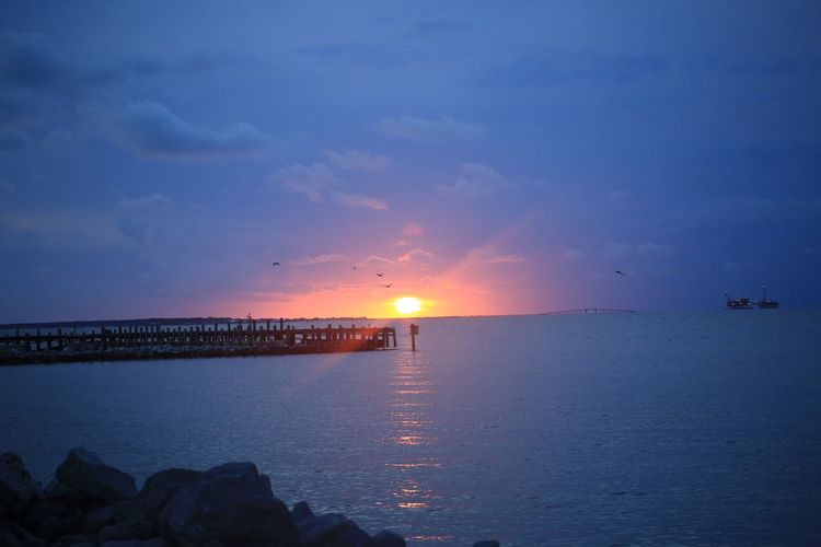 Pier Clouds Fort Morgan Mobile Bay Alabama Water Sky Sunset Sea Scenics - Nature Beauty In Nature Sun Tranquil Scene Horizon Over Water Horizon Tranquility Idyllic Beach Nature Reflection Sunlight Land No People Cloud - Sky Outdoors The Great Outdoors - 2018 EyeEm Awards