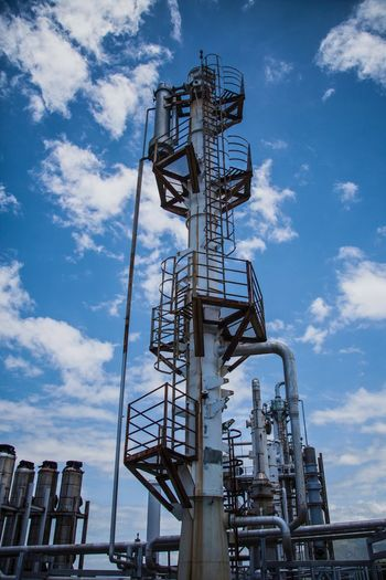 Tower Oil Refinery Industrial Equipment Refinery Tower Technology Building Exterior Tall - High Factory Oil Industry Outdoors Fuel And Power Generation No People Metal Day Architecture Built Structure Industry Low Angle View Cloud - Sky Sky Motagua