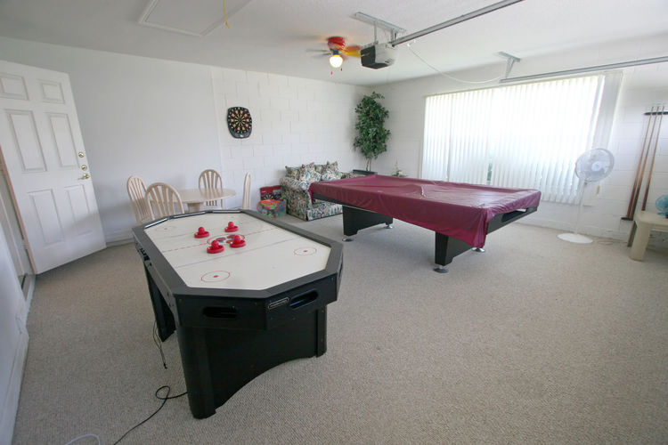 A Games Room with Pool Table and Air Hockey Table. Air Hockey Architecture Built Structure Ceiling Chair Domestic Room Equipment Flooring Furniture Games Room Home Interior Indoors  Lighting Equipment No People Pool Table Seat Table
