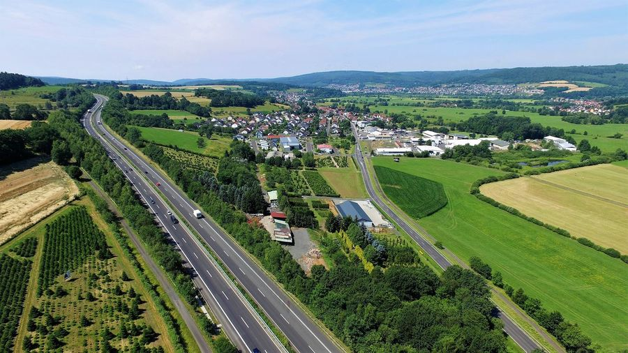 View from a drone of a german Autobahn, towns and nature Beautiful Landscape Aerial View Aerial View German Autobahn Aerial View Highway Aerial View Landscape Aus Der Sicht Einer Drohne Autobahn Beautiful Landscape Beauty In Nature DJI Phantom 3 Advanced Drohnenbild Drohnenflug Drone Skyview Dronephotography German Autobahn German HighWay High Angle View High Angle View Nature Laandscape In Germany Landscape Landschaft Luftaufnahme Luftbild Luftbild Autobahn Nature Towns In Germany