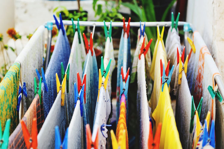 Close-up of multi colored flags hanging for sale