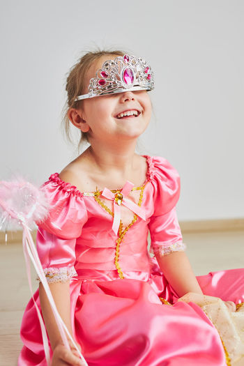 Little girl enjoying her role of princess. adorable cute 5-6 years old girl wearing princess dress