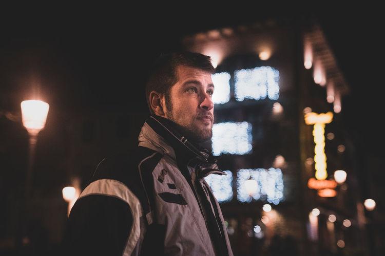 Man looking away at night