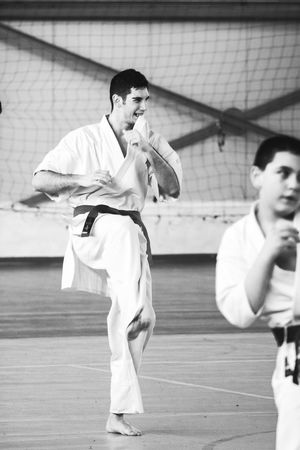 New Year's Resolutin: Train Harder! Balance Black And White Concentration Concentrationcamp Equilibrium EyeEm Best Shots Instructor Karate Martial Arts Martial Arts Children Mentor New Years Resolutions 2016 Photooftheday Showcase: December Sitting The Week Of Eyeem Train Hard Training Work Hard Play Hard Working Hard Youth Of Today Alternative Fitness Showing Imperfection Finding New Frontiers