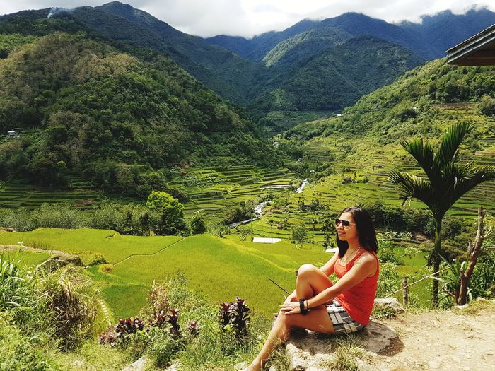 Philippines Nature Banaue Rice Terraces Rice Field Manmade Young Women Sitting Relaxation Women Beautiful Woman Full Length Sky Grass Tranquil Scene Calm Scenics Remote The Traveler - 2018 EyeEm Awards The Great Outdoors - 2018 EyeEm Awards
