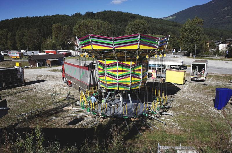 Abundance Amusementpark Arrangement Circus Decoration Dramatic Angles Large Group Of Objects Luna Park Mountain Multi Colored Sky Street TakeoverContrast Variation Vibrant Color