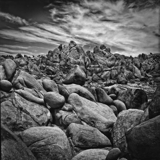 Alabama Hills Lone Pine California at midday,film using Ilford Delta medium format Beach Beauty In Nature Black And White, Cloud - Sky Day EyeEm And Getty EyeEm Gallery Film, Getty Images Hasselblad, 500C, Jeffrey Sinnock Nature No People Outdoors Pebble Pebble Beach Rock - Object Scenics Sea Sky Tranquility Water