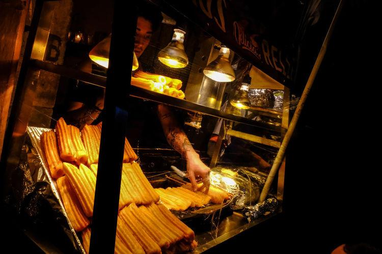 Man preparing food in restaurant at night