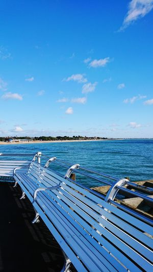 Sea Blue Water Pier Benches Bench Empty Seat Sky No People Outdoors Day Shadow Winter Sun Beach Cloud - Sky Nature Scenics South Parade Pier