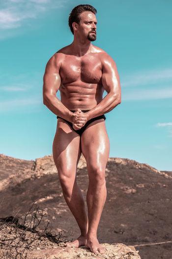 Body builder posing outdoors