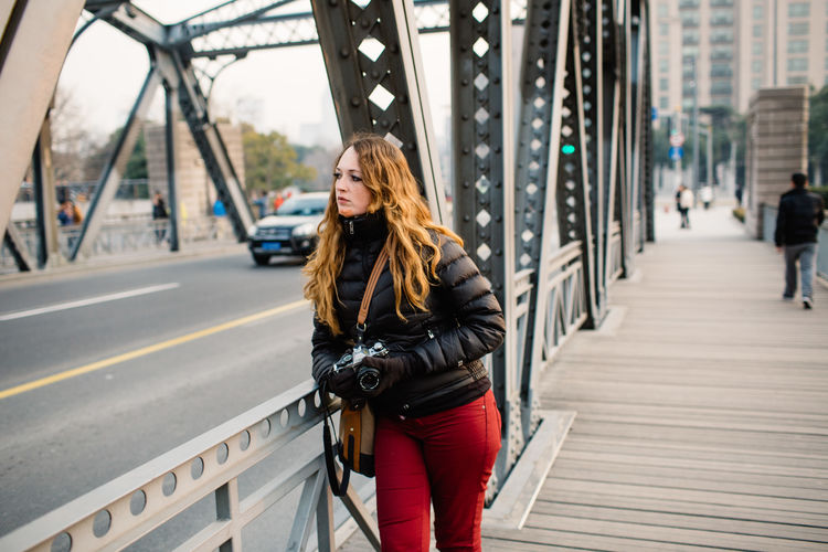 A day trip! Be. Ready. Adult Adults Only Architecture Bridge - Man Made Structure Built Structure Casual Clothing City Day Focus On Foreground Leisure Activity Lifestyles One Person Outdoors People Real People Warm Clothing Young Adult