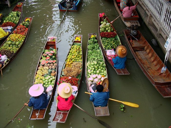 High angle view of vendors on floating market in river