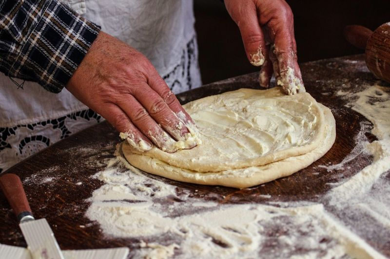 Making cookies EyeEmNewHere Food And Drink Pastry Dough Preparation  Flour Human Hand Preparing Food Senior Adult Food And Drink Human Body Part Indoors  Kneading Midsection Rolling Pin Making Real People One Person Holding Skill  Table Senior Men Food