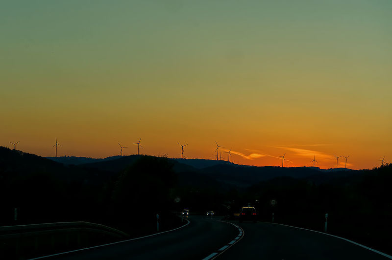 Silhouette of road during sunset