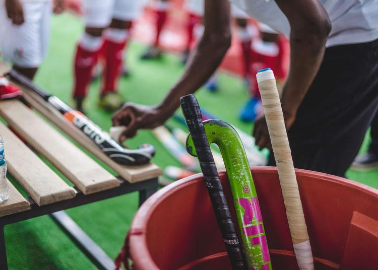 Hockey sticks in bucket