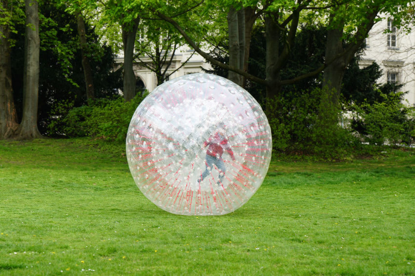 Zorbing Ball Childhood Day Fun Giant Grass Kid Orb Outdoor Outdoors Park Plastic Play Playing Recreation  Rolling Sport Unrecognizable Zorb Zorbing
