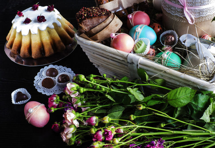 High Angle View Of Easter Basket With Flowers On Table