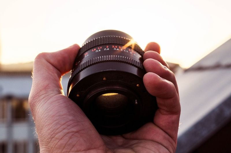 rooftop Photography Themes Human Hand Photographing Adult Camera - Photographic Equipment Holding Human Body Part Photographer One Person Outdoors People Only Men Adults Only Day City Close-up Men One Man Only