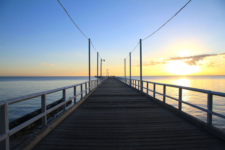 Great way to start the day...seeing the run rise on a beautiful morning by the sea! Pier Beauty In Nature Diminishing Perspective Direction Horizon Horizon Over Water Idyllic Jetty Long Nature No People Orange Color Outdoors Pier Railing Scenics - Nature Sea Sky Sunrise Sunrise Over Pier The Way Forward Tranquil Scene Tranquility Water Wood Paneling