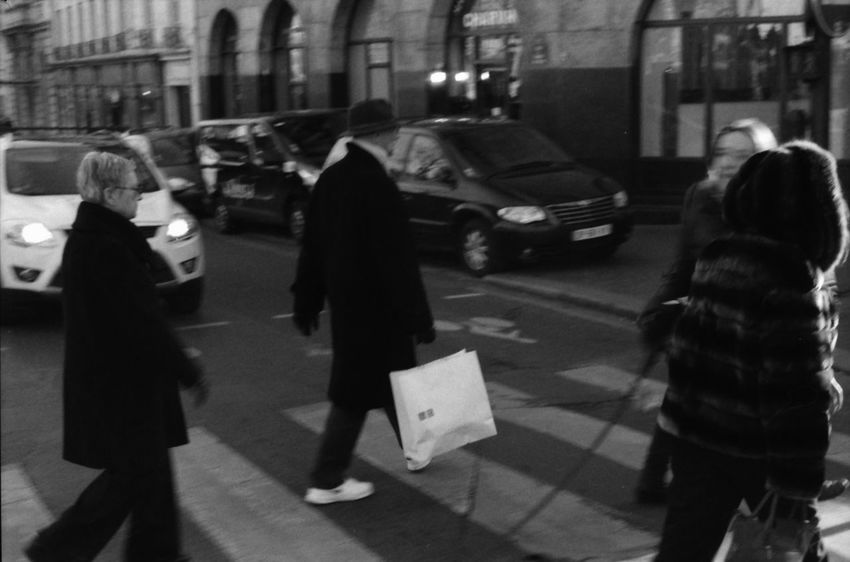 Crosswalk Adult Architecture Building Exterior Built Structure Car City Full Length Group Of People Men Motion Outdoors Pedestrian People Real People Rear View Road Shoppingbag Street Walking Women First Eyeem Photo