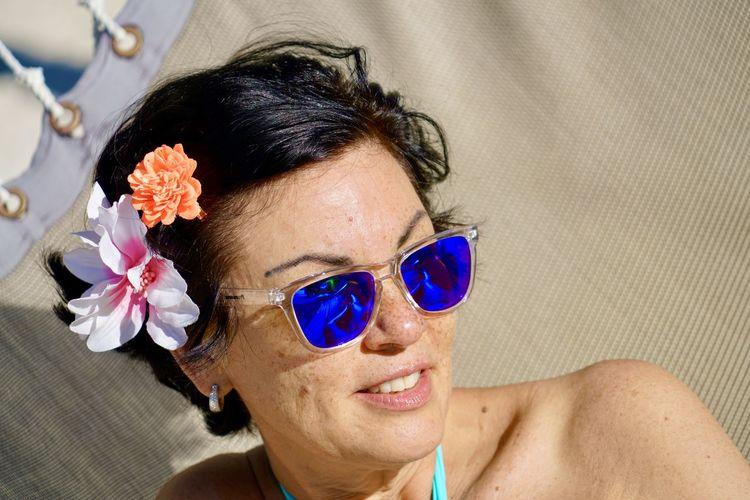 Portrait of woman wearing sunglasses