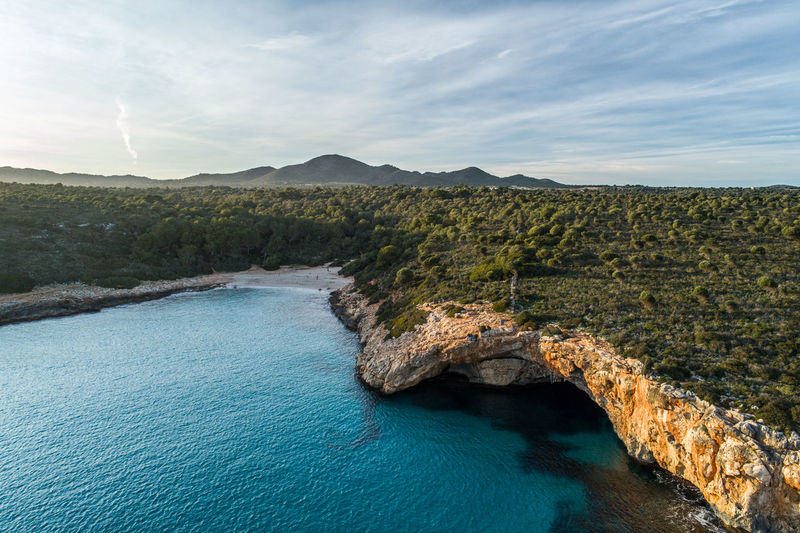 Mallorca Beach Bay Coast Shore Secret Nature Summer Sunset Aerial View Aerial Drone  View Landscape CalaVarques Cala Varques Rock Cliff Turquoise Colored Environment Outdoors Mountain Beauty In Nature Sea Mediterranean Sea