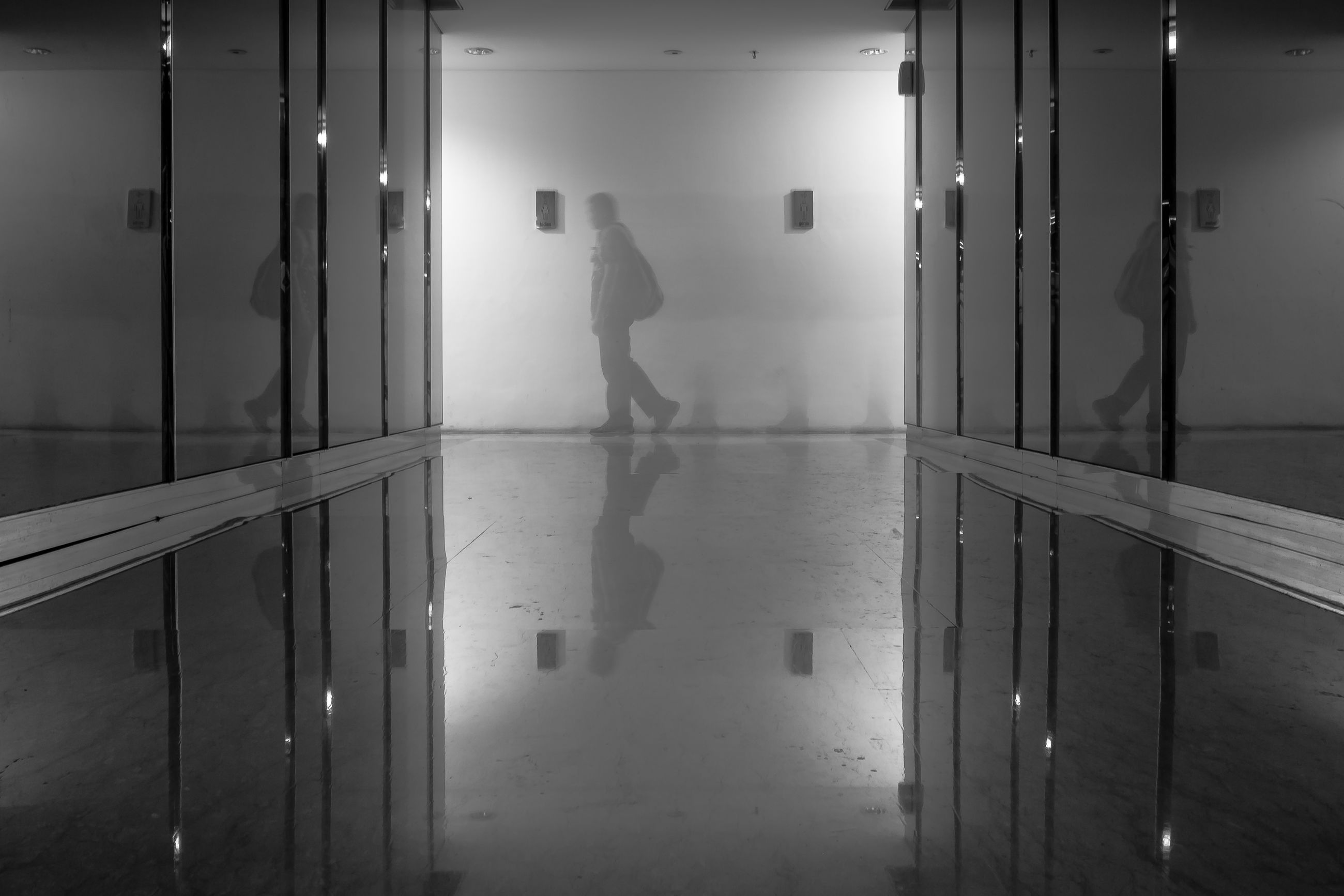 one person, indoors, real people, men, entrance, lifestyles, standing, door, flooring, full length, reflection, leisure activity, building, dressing room, silhouette, domestic room, unrecognizable person, architecture, corridor