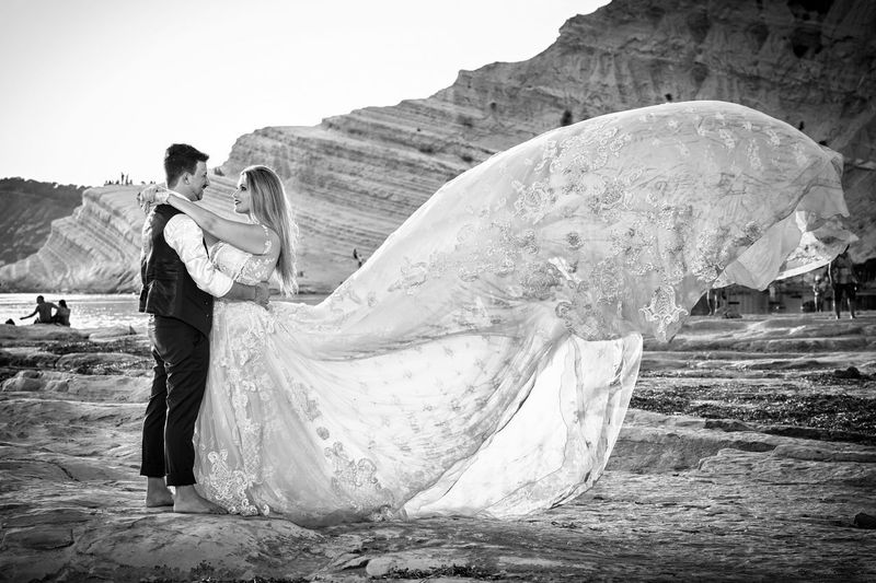 Adult Couple - Relationship Day Emotion Full Length Incidental People Land Leisure Activity Lifestyles Men Nature Outdoors People Real People Sky Standing Water Wedding Wedding Dress Women Young Adult
