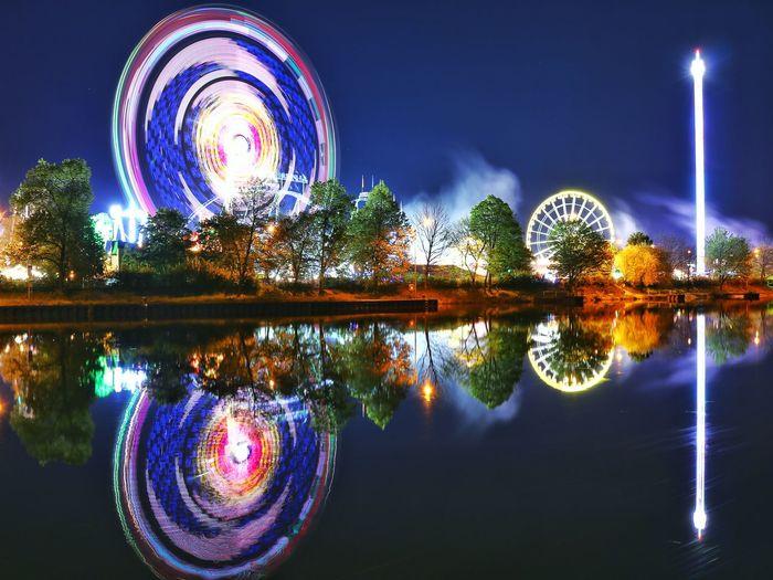 Reflection of illuminated lights on water at night