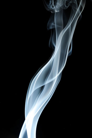 Abstract Black Background Burning Changing Form Close-up Copy Space Curve Cut Out Flowing Incense Indoors  Luminosity Motion Nature No People Pattern Smoke - Physical Structure Studio Shot Swirl Veil Water White Color