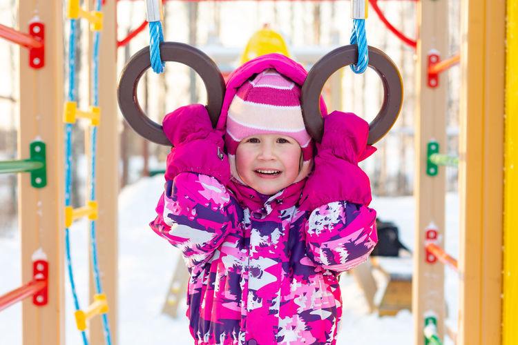 Half-length portrait of a little girl in winter in kindergarten. outdoor games, healthy lifestyle.