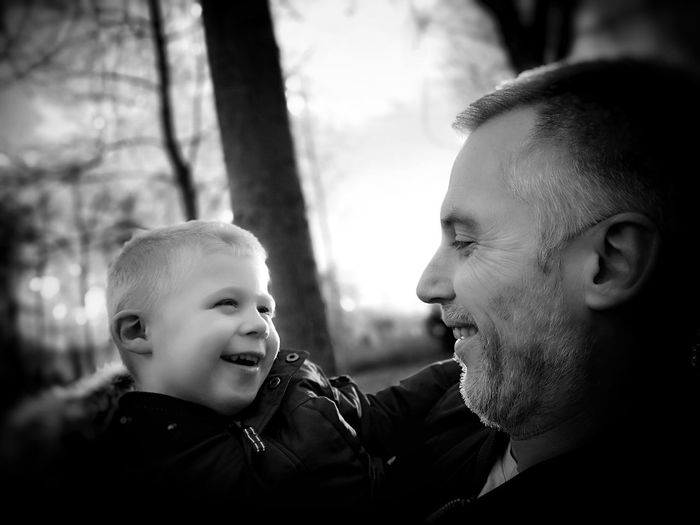 Close-Up Of Smiling Grandfather And Grandchild