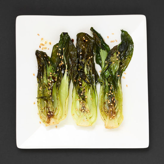 Baked bok choy or pak choi seasoned with soy sauce and roasted sesame seeds, photographed overhead with natural light Asian  Green Seed Appetizer Baked Bok Choi Bok Choy Cabbage Chinese Cruciferous Food Food And Drink Healthy Healthy Eating Healthy Food Leafy Overhead View Pak Choi Quadratic Sesame Sesame Seed Snack Soy Sauce Top View Vegetable