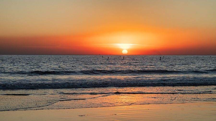 Sea Sky Water Sunset Beauty In Nature Scenics - Nature Orange Color Horizon Nature Tranquility Horizon Over Water Sun No People Tranquil Scene Land Non-urban Scene Beach Idyllic Sunlight Outdoors