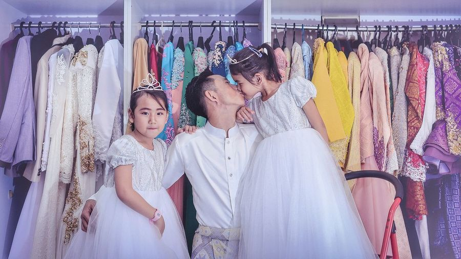 father and his beloved angel Angel Princess Coathanger Togetherness Child Store Curtain Retail  Smiling Customer  Consumerism Fashion Clothes Rack Boutique Closet Menswear Fitting Room