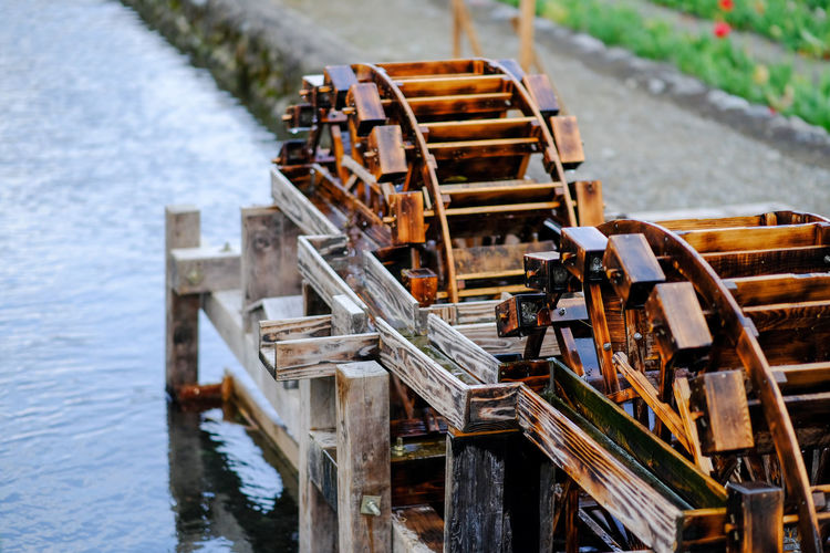 Abundance Canal Close-up Day Empty Focus On Foreground In A Row Japanese Culture No People Outdoors Selective Focus Waterwheel Wood - Material Wooden Wooden Post