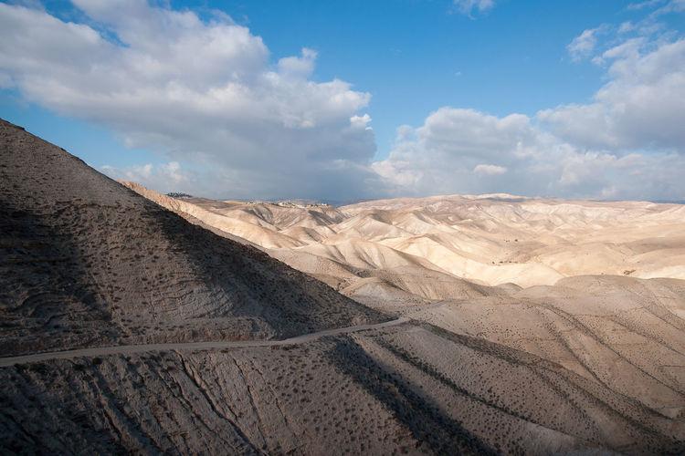 Aerial view of desert against sky