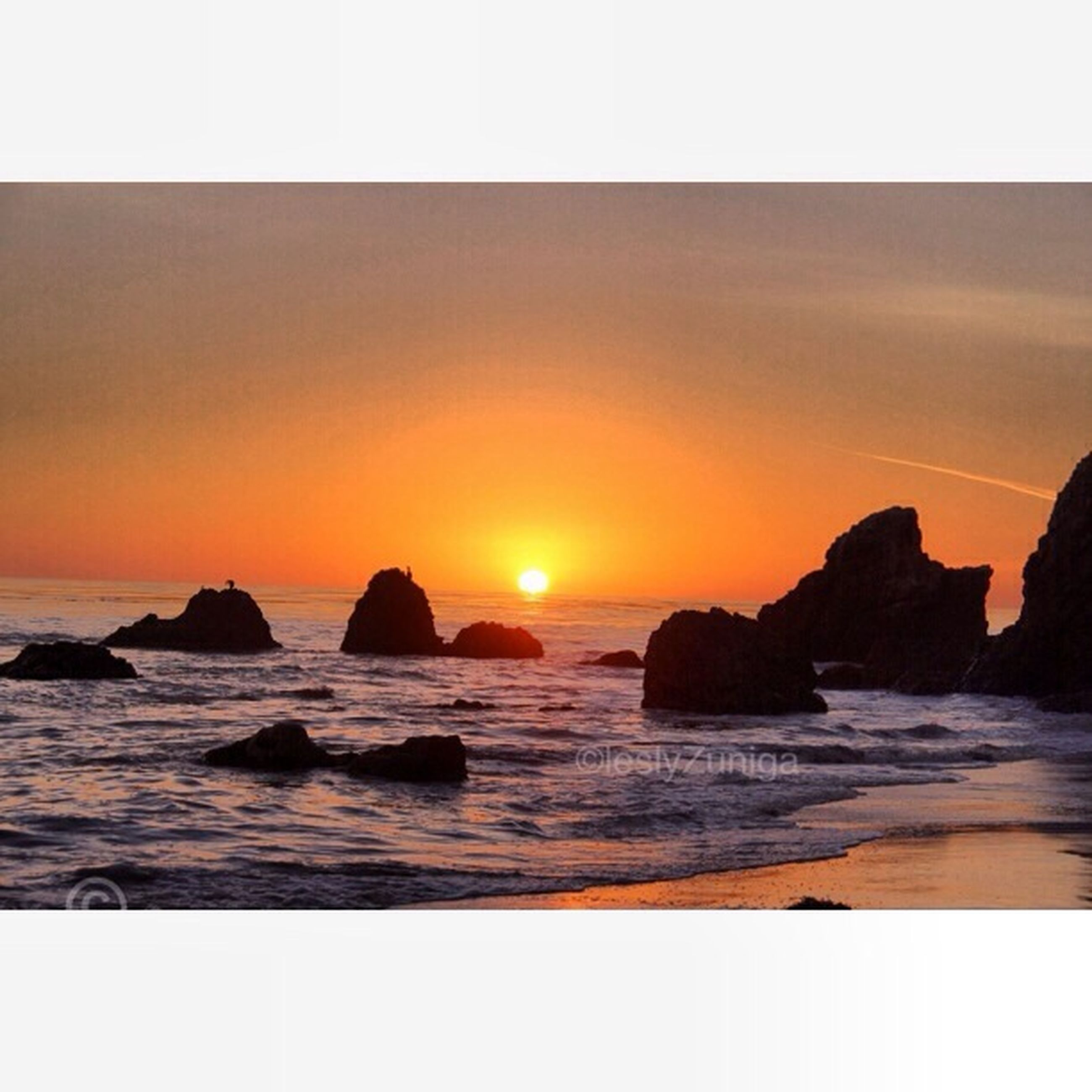 sunset, sea, water, scenics, transfer print, tranquil scene, beauty in nature, sun, horizon over water, tranquility, beach, rock - object, orange color, auto post production filter, shore, nature, idyllic, sky, rock formation, wave
