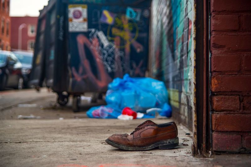 Wingtips Newyorkcity Brooklyn Used Trash Wingtips Shoes Architecture City Shoe Street Building Exterior Built Structure Day Wall Focus On Foreground City Life