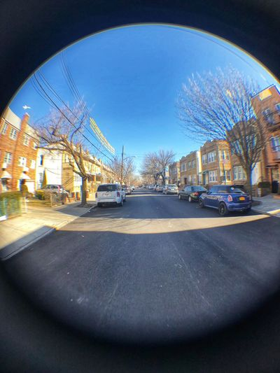 Through the fish lens Fish Eye Street Photography Fish Eye Effect FishEyeEm Transportation Land Vehicle Architecture Built Structure Car Day Mode Of Transport Clear Sky Road Blue Sunlight Sky No People Bare Tree Outdoors Fish-eye Lens