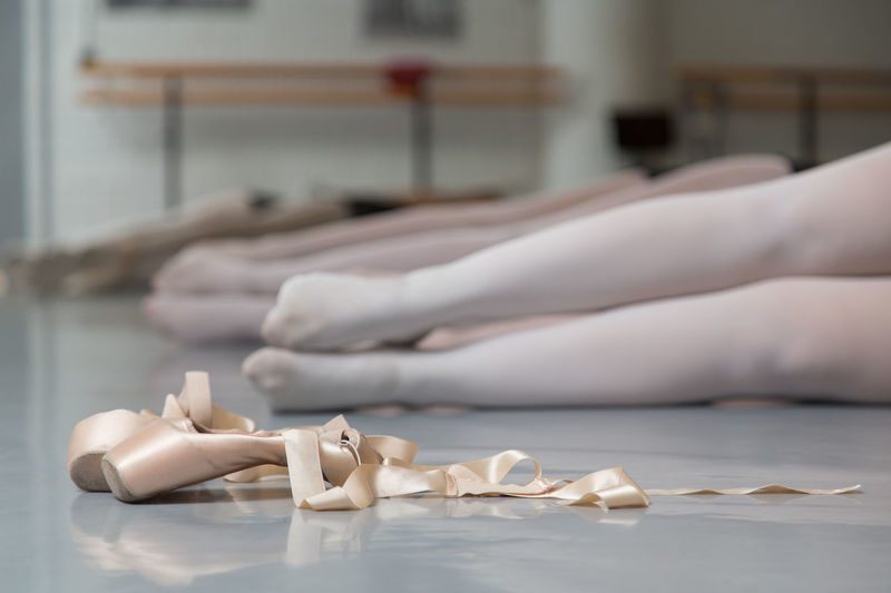 Low Section Of Ballerina On Floor In Ballet Studio