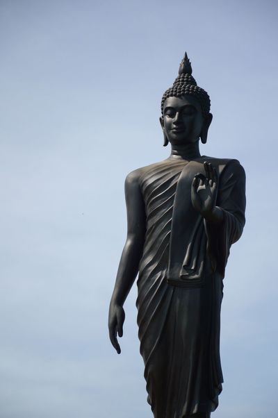 ASIA Ancient Asian  Buddha Art And Craft Black Culture Day Human Representation Iron - Metal Low Angle View Male Likeness Metal No People Outdoors Religion Sculpture Sky Spirituality Statue Temple Wat Thai