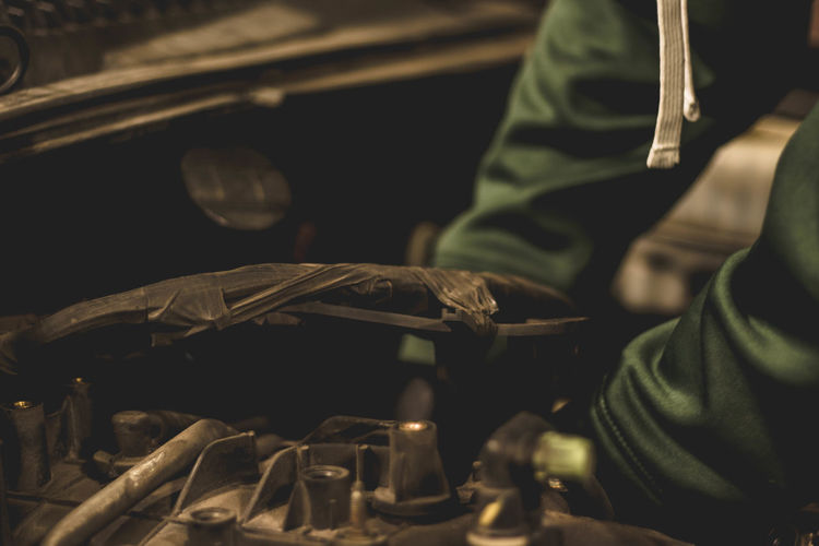 Mechanic preparing an engine for removal, working in engine compartment. Automobile Dark Engine Compartment Forearms Green Hands Mechanic SUV Work Working Auto Black Car Engine First Eyeem Photo Gloves Gloves And Helmets Human Hand Job Mechanic Shop One Person White