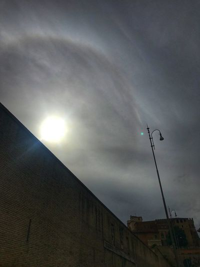 The dark from the sun Sky Cloud - Sky Low Angle View No People Architecture Built Structure Nature Sun Building Exterior Day Vertebrate Flying Sunlight Outdoors Beauty In Nature Scenics - Nature Sunbeam Lens Flare Animal Themes Flock Of Birds