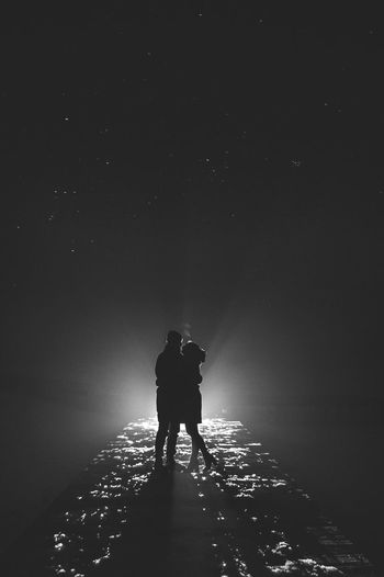 night Beauty In Nature Men Nature Night Outdoors People Real People Rear View Silhouette Sky Togetherness Two People Winter