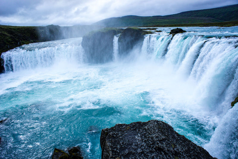 Waterfall godafoss with blue water in iceland. landscape.