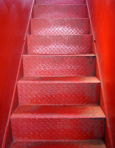 red industrial steel stairs Absence Architecture Building Built Structure Day Diminishing Perspective Direction Door Entrance High Angle View Indoors  No People Pattern Railing Red Staircase Steps And Staircases The Way Forward Wall - Building Feature