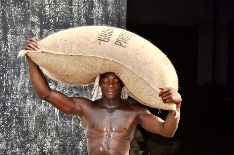 Portrait of shirtless man wearing hat