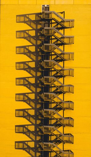 Fire escape in yellow building